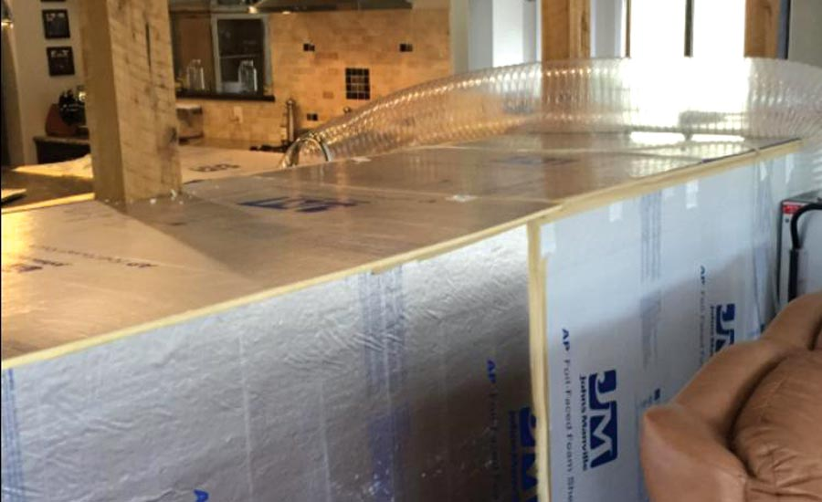 A loop drying system is being used to save a solid wood floor.