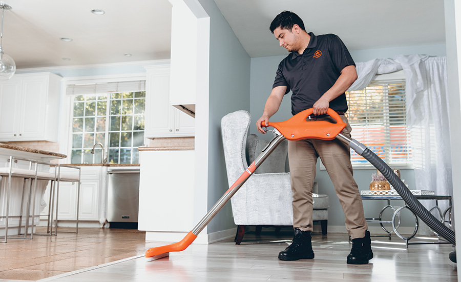a man vacuuming