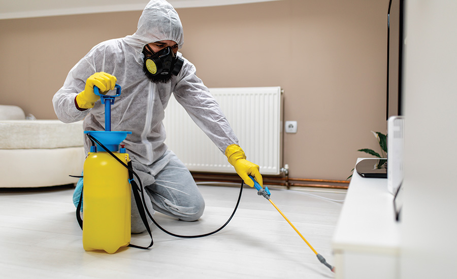 person wearing PPE cleaning