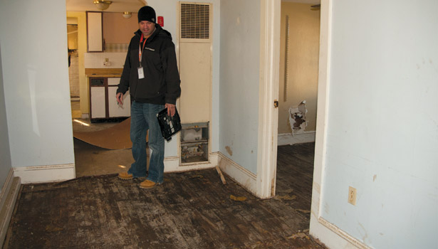 fema man flooded house hardwood