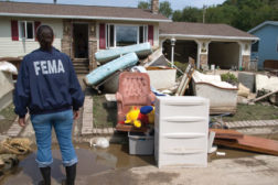 woman fema jacket ruined home