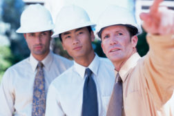 men on job site pointing