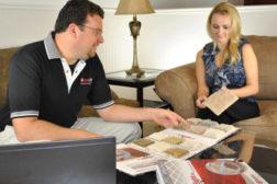 carpet salesmen with woman customer