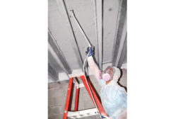 man restoring beams